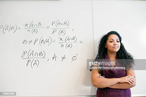 Student at whiteboard in math class