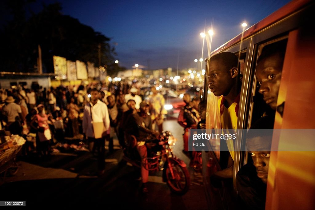 Student athletes from the l'�cole de soccer des Brasseries Cameroun look out their bus taking them home from a match, May 26, 2010 in Douala, Cameroon.