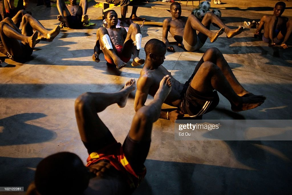 Student athletes from the l'�cole de soccer des Brasseries Cameroun stretch after winning a match, May 26, 2010 in Douala, Cameroon. The students in the soccer academy spend their days training and studying.
