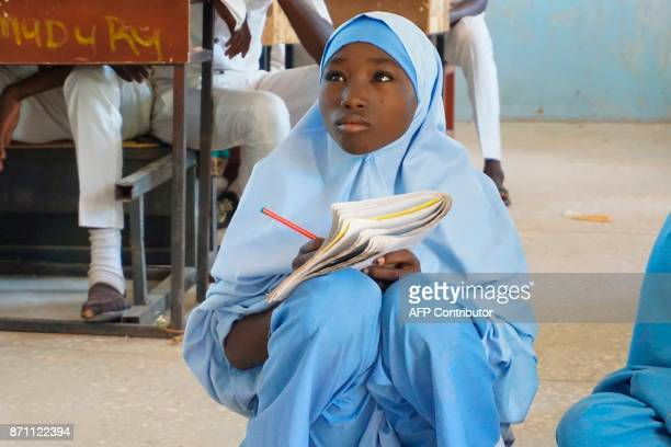 A student attends a class at the Government Day Secondary School Muduru near Katsina on November 3 2017 The 'Science on Wheels' project is the...