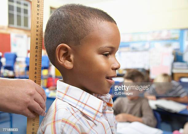 A student being measured in class