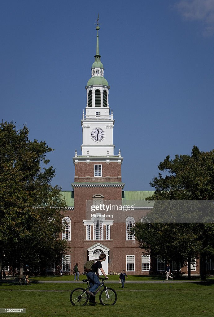 A student bikes through the Dartmouth College campus the day before a Republican presidential debate sponsored by Bloomberg via Getty Images and The...