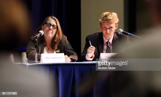 Student board member Nathan Moore right and board member Mary Ann Stewart listen to a report during a Massachusetts Board of Elementary and Secondary...