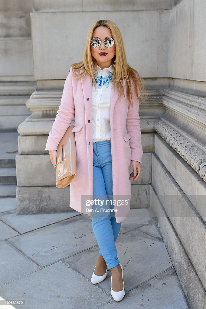 Student Carly 23 poses wearing a coat by Misguided with Zara trousers and necklace with a Burberry blouse Faye District bag with Vintage shoes at the...