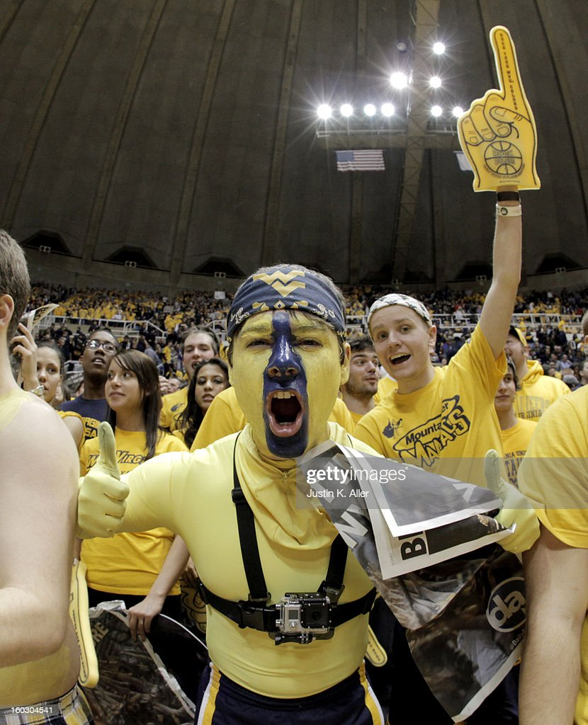 A WVU student cheers against the Kansas Jayhawks at the WVU Coliseum on January 28, 2013 in Morgantown, West Virginia.