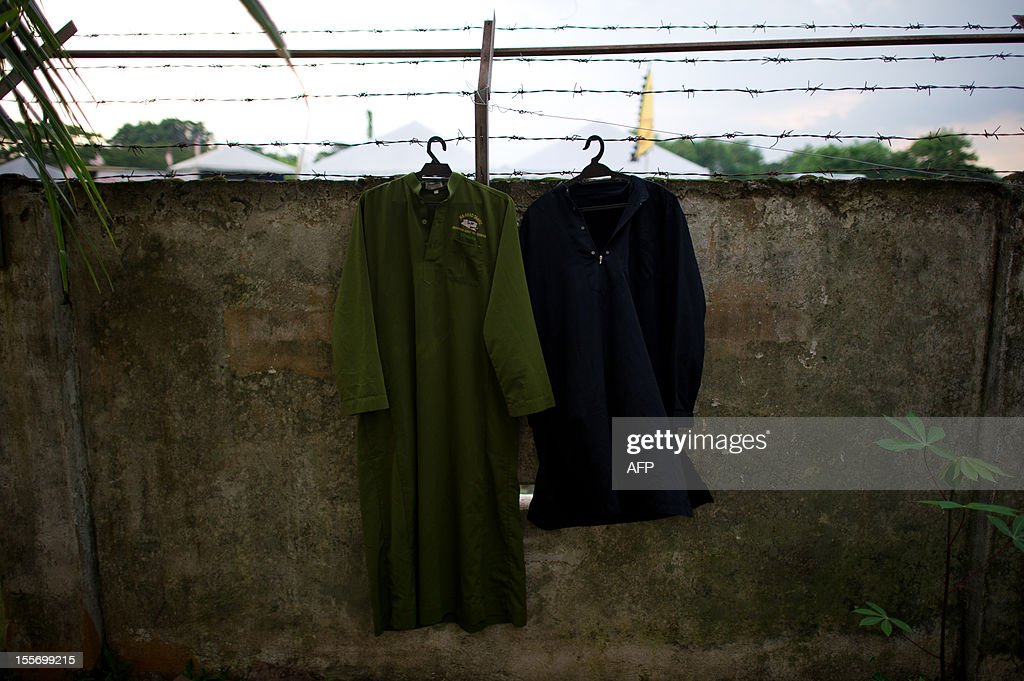 Student cloths are seen hanging on the wall at the Iqro Al-Quran Bestari academy for the orphanage in the suburbs of Kuala Lumpur on November 7, 2012.