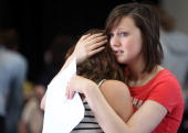 A student comforts a friend after they had just opened their Alevel results at Hayesfield Girls' School on August 19 2010 in Bath England Thousands...