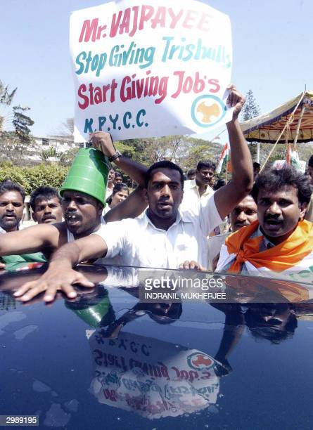 Student Congress party workers clean cars to symbolically earn money as they protest against the Atal Behari Vajpayee led coalition union government...