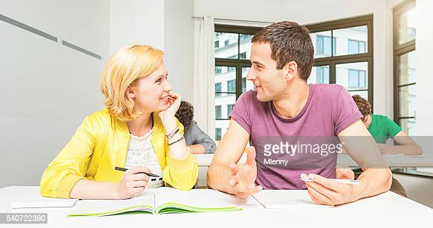 Student couple chatting in classroom
