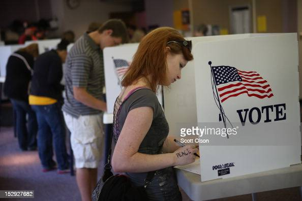 Student Courtney Johnson votes on the campus of the University of Northern Iowa on September 28 2012 in Cedar Falls Iowa Voters filled the polling...