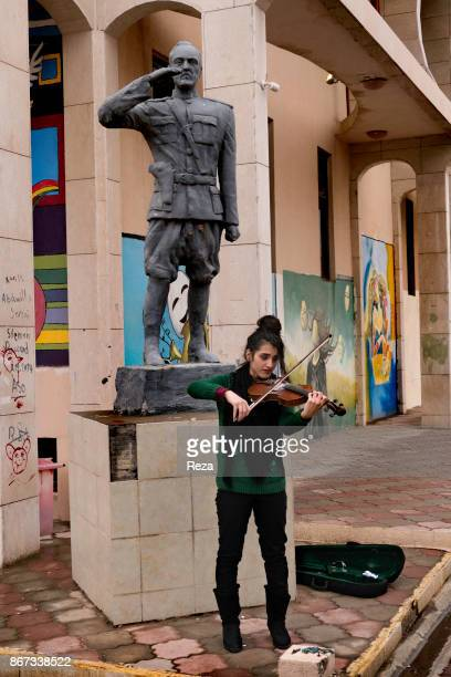A student displaced from Mosul and studying in the department of Musicology at the Salahaddin University plays vilion The university attract students...