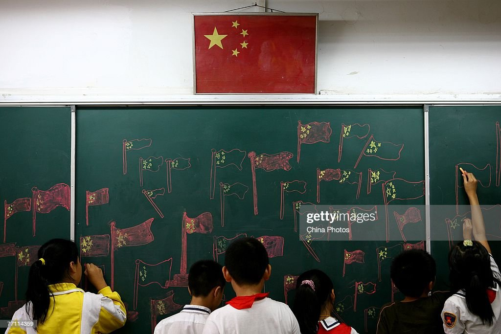 Student draw the Chinese national flag on a chalkboard during an activity to mark National Day September 30, 2007 in Nanjing of Jiangsu Province, China. The week-long National Day holiday will start October 1, one of three 'Golden Weeks' holidays in China.