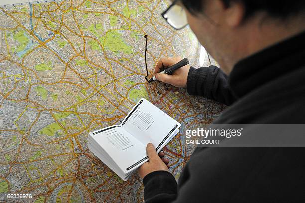 A student draws a route on a map of London in a test centre in north London on February 28 2013 All London Black Cab drivers are required to pass the...