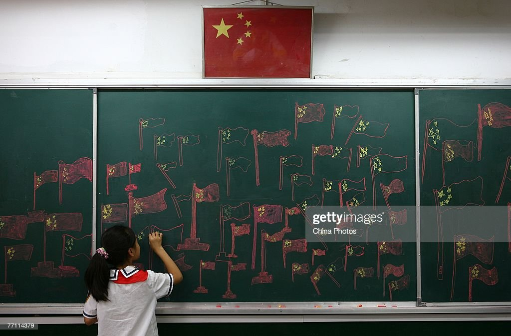 A student draws the Chinese national flag on a chalkboard during an activity to mark National Day September 30, 2007 in Nanjing of Jiangsu Province, China. The week-long National Day holiday will start October 1, one of three 'Golden Weeks' holidays in China.