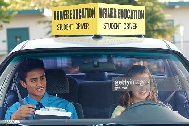 A student driver with her driving instructor