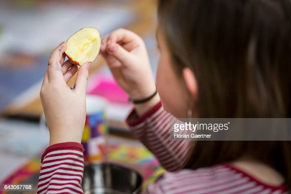 A student eats an apple during the school break Feature at a school in Goerlitz on February 03 2017 in Goerlitz Germany