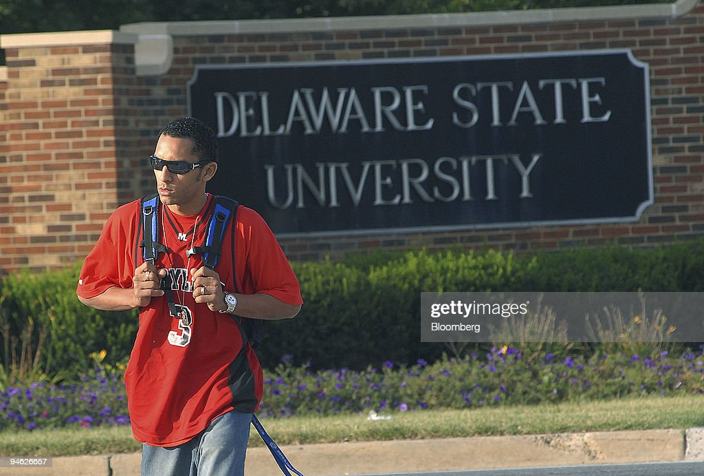 Student Edwardo Rivera walks away from an entrance to the Delaware State University campus after finding campus closed due to an earlier shooting...