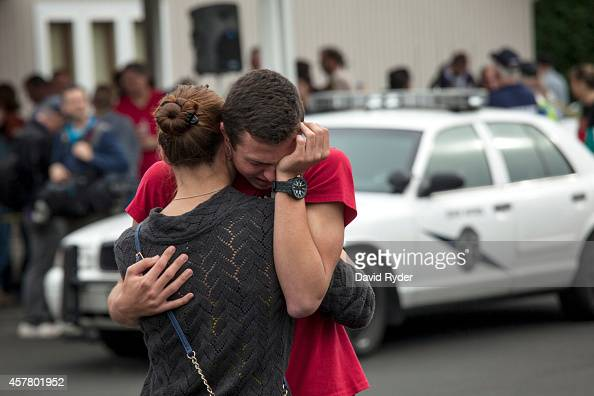 A student embraces a family member at Shoultes Christian Assembly after being evacuated from MarysvillePilchuck High School in the aftermath of a...