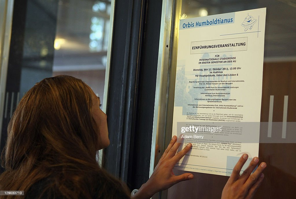 A student employee hangs a flyer advertising an international student orientation event prior to the beginning of the winter semester on October 11, 2011 in Berlin, Germany. German universities recorded a record 2.218 million matriculations in the 2010/2011 winter semester, a rise of 4.5%, and expect even more students in the coming winter semester, which starts in October. The end of compulsory military service in the Bundeswehr, the German armed forces, which went into effect earlier this year, is a major contributing factor to the rise in the numbers of students arriving at universities across the country.