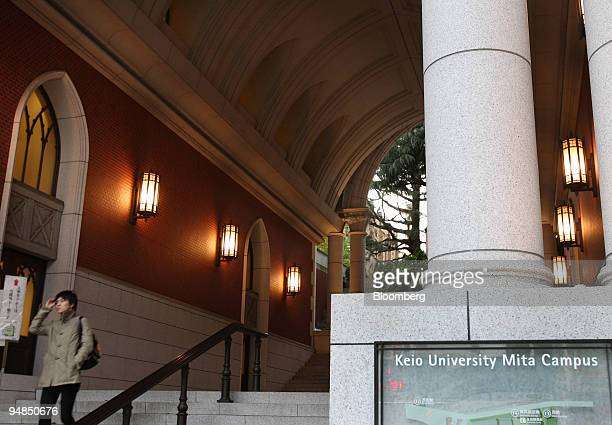 A student exits Keio University in Tokyo Japan on Wednesday Nov 19 2008 Japan's top universities are falling victim to the global financial crisis...