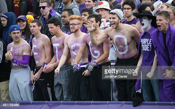 Student fans of the Northwestern Wildcats cheer on their taem against the Minnesota Golden Gophers at Ryan Field on October 3 2015 in Evanston...