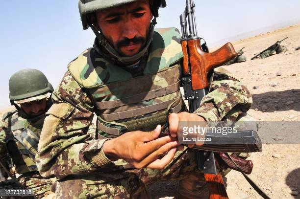 A student from the Afghan security forces belonging to the NCOBC loads an ammunition clip as he attends a training supervised by Italian military...