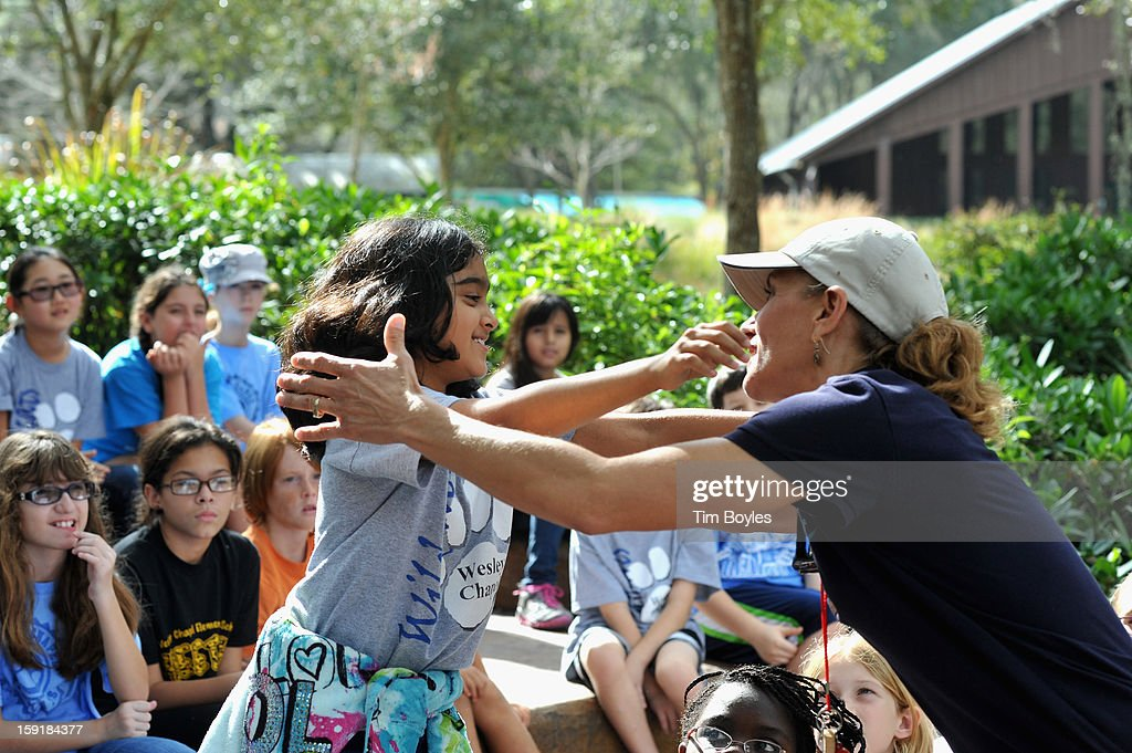 A student gets a hug for a correct answer during the unveiling of WaterVentures, Florida's Learning Lab at Crystal Springs Preserve in partnership with Zephyrhills Brand 100% Natural Spring Water on January 9, 2013 in Crystal Springs, Florida. (Photo by Tim Boyles/Getty Images for Zephyrhills