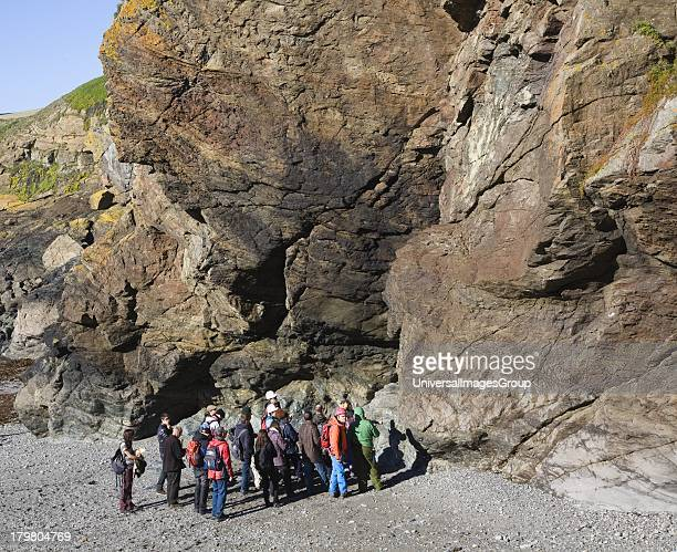Student group of geologists on a fieldtrip at Polpeor Cove Lizard Point Cornwall England