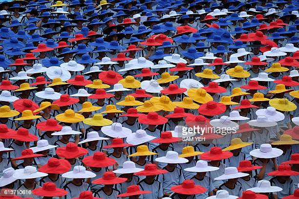 TOPSHOT Student groups perform during National Day celebrations in front of the Presidential Palace in Taipei on October 10 2016 Taiwanese President...