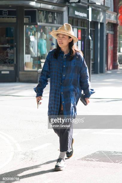 Student Han Yb wears Doc Martens shoes Vivienne Westwood shirt belt and hat Trousers from china on day 3 of London Collections Men on June 11 2017 in...