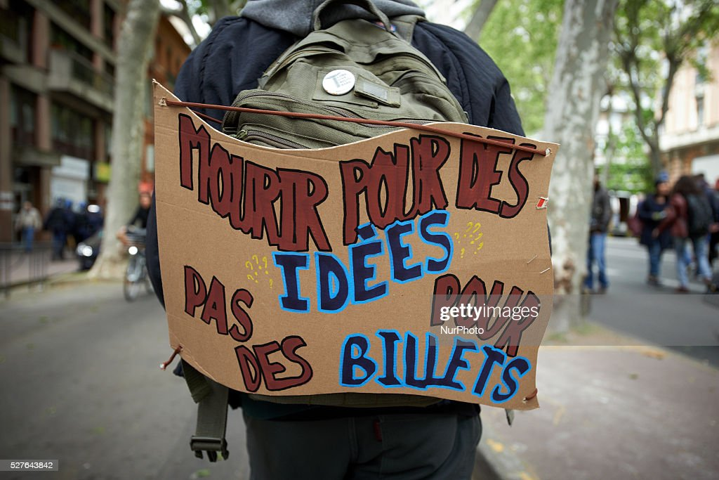 A student has attached a placard reading 'Die for ideas, not for banknotes' during a protest against the El-Khomri bill on labour reforms. Toulouse. France. May 3th 2016.