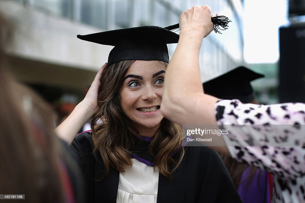 A student has her hat adjusted by her mother ahead of her graduation ceremony at the Royal Festival Hall on July 15, 2014 in London, England. Students of the London College of Fashion, Management and Science and Media and Communication attended their graduation ceremony at the Royal Festival Hall today.