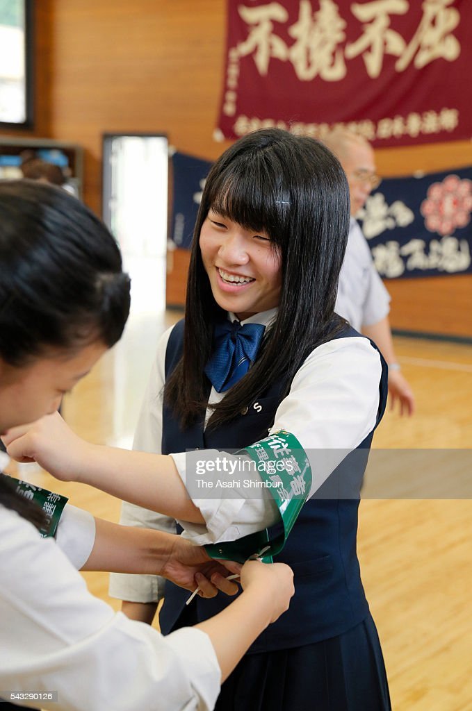 A student helps at an early polling station wears an armband at Kashihara High School on June 27, 2016 in Kashihara, Nara, Japan. From the Upper House election, taking place on July 10, the age of voters lowers to 18.