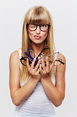 Student holding heap of glasses in studio