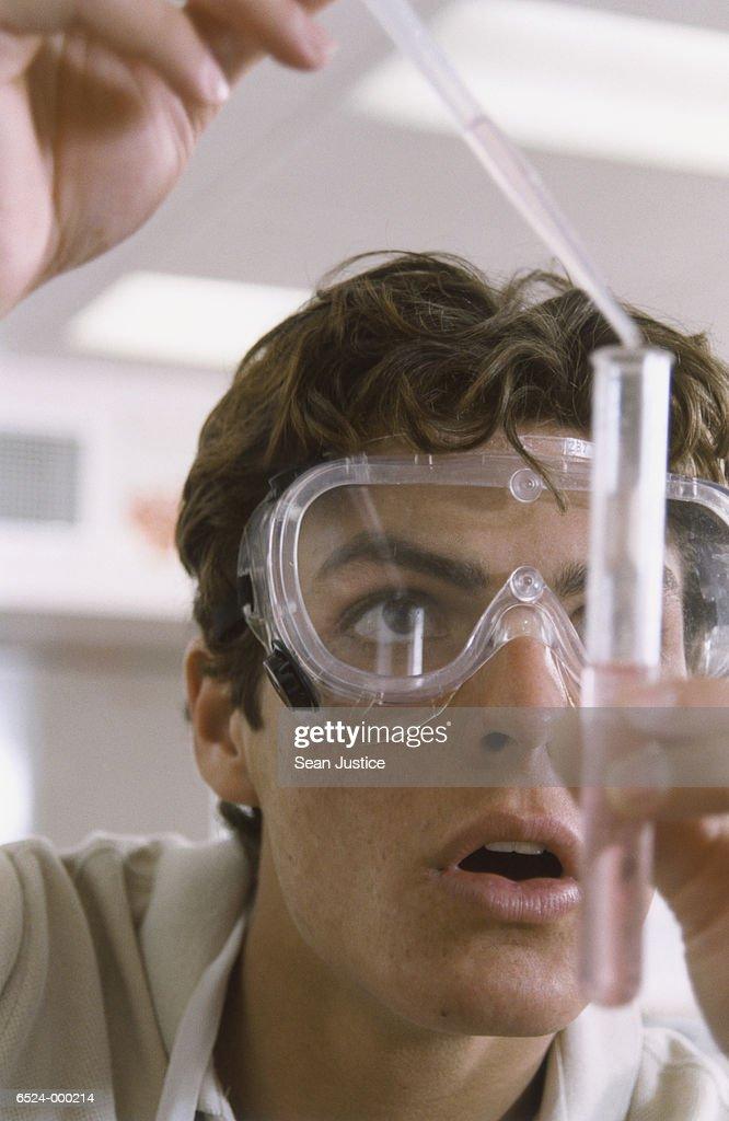 Student Holding Test Tube : Stock Photo