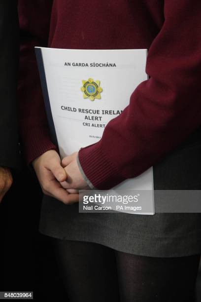 A student holds a copy of The Child Rescue Ireland Alert plan at the launch of the The Child Rescue Ireland Alert systerm at garda Headquarters in...