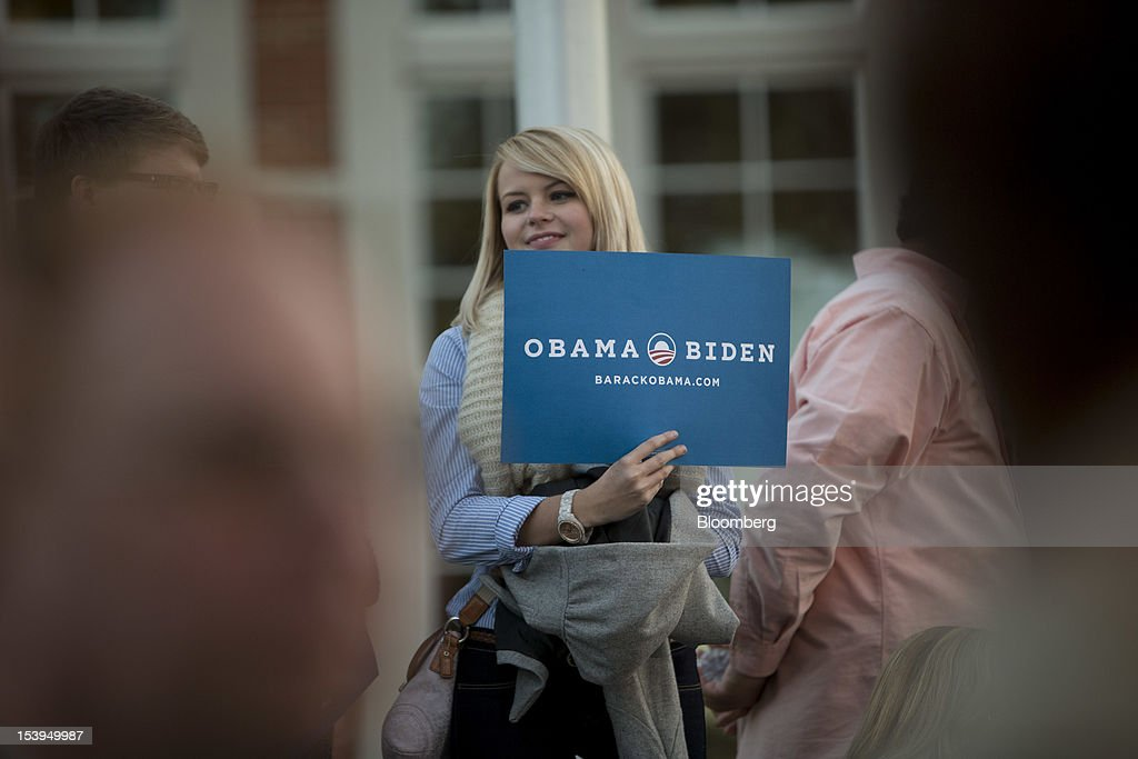 A student holds up a sign in support of U.S. President Barack Obama, before the start of a debate in Danville, Kentucky, U.S., on Thursday, Oct. 11, 2012. The vice presidential debate at Centre College in Danville, Kentucky, has taken on greater significance after a majority of voters said President Barack Obama lost to former Massachusetts Governor Mitt Romney in their first showdown on Oct. 3. Romney has surged in national and state polls. Photographer: Scott Eells/Bloomberg via Getty Images