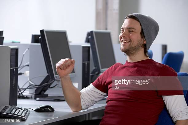 Student in computer lab showing success