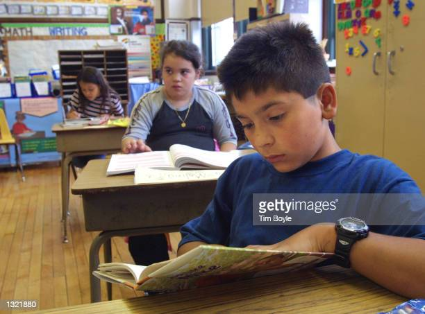 A student in Ms Newman''s third grade class reads a book during summer school July 3 2001 at Brentano Academy in Chicago More than half of Chicago''s...