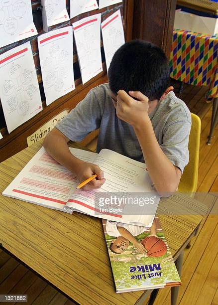 A student in Ms Newman''s third grade class works on a problem during summer school July 3 2001 at Brentano Academy in Chicago More than half of...