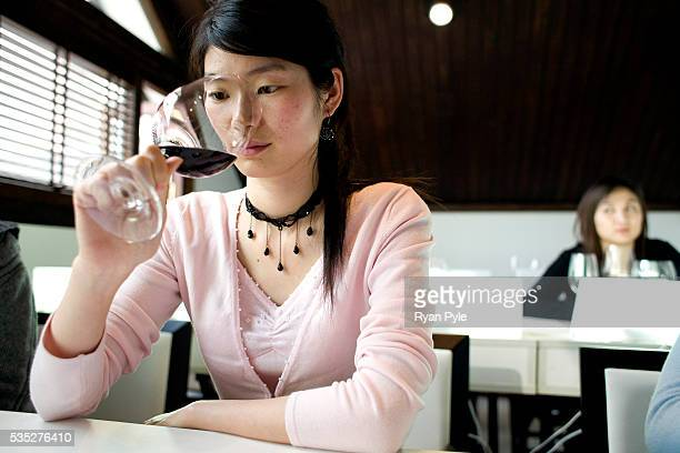 A student inspects wine during a wine education class at the Wine Residence run by ASC Fine Wines in Shanghai China The Wine culture is picking up...