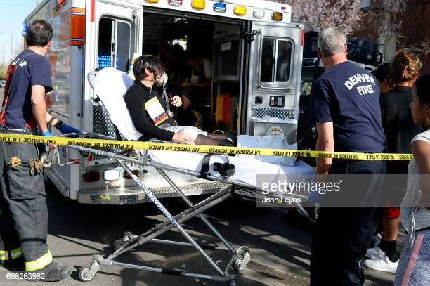 A student is put in the ambulance as other paramedics work on kids at 39th Tejon after their school bus they were in was hit by a Jeep Grand Cherokee...