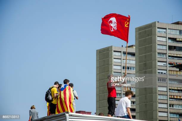 A student is seen raising the flag with the face of Lenin More than 15000 students gathered to the streets to demonstrate against the Spanish...