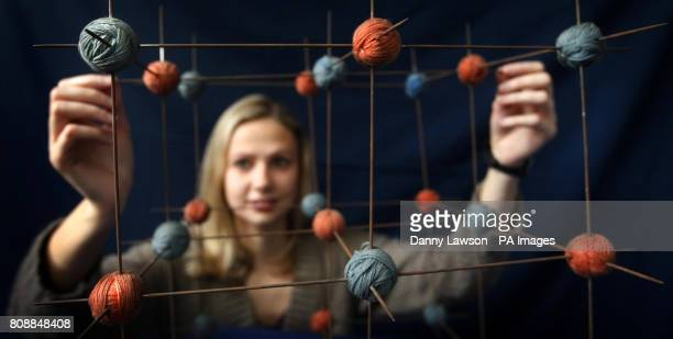 Student Isobel Marr with a molecular model of common salt made from balls of wool and knitting needles Currently on display at the King's Buildings...