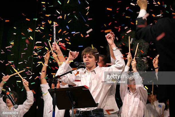 Student Jacob Glatter raises his arms as confetti falls after singing a solo during the High School performance of the Little Drummer Boy at the...