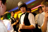 Student James Pervis tries on a friends hat during the prom at St James' Park on July 1 2011 in Newcastle United Kingdom After months of preparation...