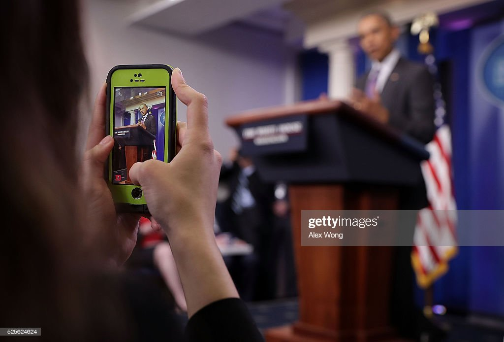 A student journalist photographs U.S. President Barack Obama at a 'daily briefing' at the James Brady Press Briefing Room of the White House April 28, 2016 in Washington, DC. College student journalists were participating in the first College Reporter Day, an opportunity to discuss issues of importance to college campuses with administration officials.