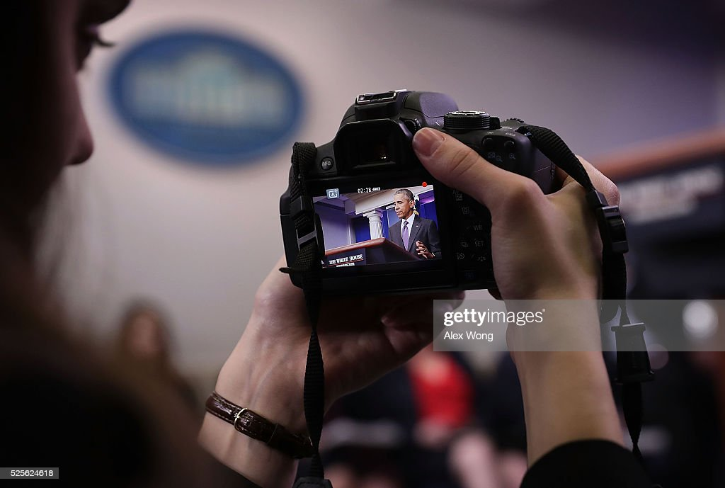 A student journalist records video of U.S. President Barack Obama at a 'daily briefing' at the James Brady Press Briefing Room of the White House April 28, 2016 in Washington, DC. College student journalists were participating in the first College Reporter Day, an opportunity to discuss issues of importance to college campuses with administration officials.