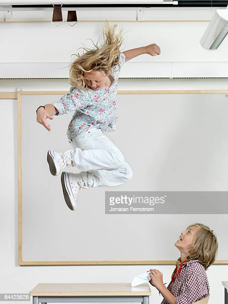 Student jumping on a bench