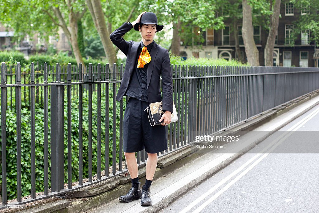 Student Kan Takahashi wears Foot the Coacher shoes, Ato jacket, Lad Musician shirt and vintage bag, tie and shorts on day 3 of London Collections: Men on June 18, 2013 in London, England.